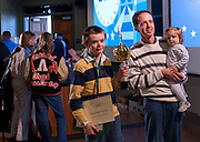 Matthew Pitcock of Maysville Middle School located in Zanesville, OH, holds his trophy while posing for a picture with his father and sister, Tom and Alice Pitcock, after being named the Southeastern Ohio Regional Spelling Bee champion Saturday, March 16, 2013. The Regional Spelling Bee was sponsored by Ohio University's Scripps College of Communication and held in Margaret M. Walter Hall on OU's main campus.