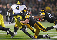 October 10, 2009: Iowa linebacker Troy Johnson (48) hits Michigan running back Brandon Minor (4) during the first half of the Iowa Hawkeyes' 30-28 win over the Michigan Wolverine's at Kinnick Stadium in Iowa City, Iowa on October 10, 2009.