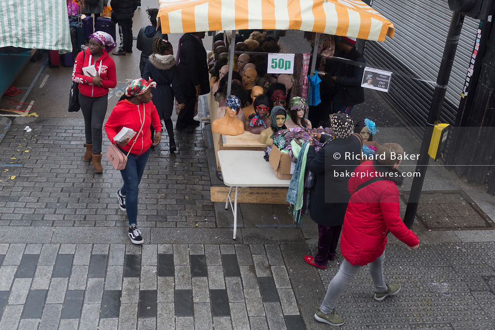 A market stall selling womens' headwear at East Street Market onthe Walworth Road, Southwark, on 9th April 2019, in London, England.