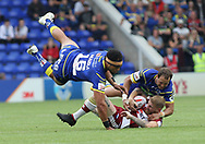 Sitaleki Akauola and Tyrone Roberts of Warrington Wolves tackle Sam Tomkins of Wigan Warriors during the Ladbrokes Challenge Cup Quarter Final match at the Halliwell Jones Stadium, Warrington.<br /> Picture by Michael Sedgwick/Focus Images Ltd +44 7900 363072<br /> 02/06/2018