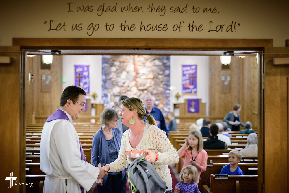 The Rev. Mark Nierman, pastor of Mount Olive Lutheran Church, greets parishioner Shelley Haagenson and her three children, Delaney, Bella, and Oliver, after Lenten worship on Wednesday, March 2, 2016, in Loveland, Colo. LCMS Communications/Erik M. Lunsford