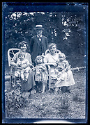 family posing in garden France ca 1920s