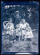 family posing in garden France ca 1920s