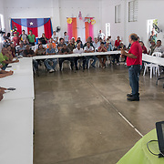 AUGUST 27, 2018--PATILLAS---PUERTO RICO--<br /> Agronomer Manuel Diaz Rivera, talks to attendees listen to astronomers during a dfistribution event for local farmers at a GUPE center in the Guardaraya community of Patillas.<br /> (Photo by Angel Valentin/Freelance)