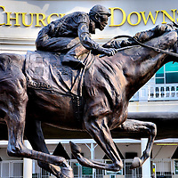 Barbaro Sculpture at Churchill Downs by Alexa King in Louisville, Kentucky<br /> At the entrance to Churchill Downs and their museum is this sculpture of Barbaro by Alexa King. This thoroughbred racehorse was undefeated before winning the Kentucky Derby in 2006. However, he shattered his back leg during the Preakness Stakes two weeks later and had to be euthanized. The horse&rsquo;s remains are beneath this monument.