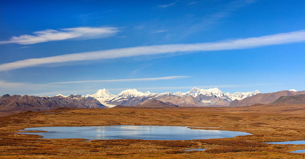 Tundra lake, Maclaren Glacier, and Alaska Range in Southcentral Alaska. Autumn. Afternoon.