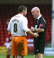 Photo: Dave Linney.<br />Walsall v Blackpool. Coca Cola League 1. 31/12/2005.<br />John Doolan(Blackpool) is booked by referee   SJ Dorr