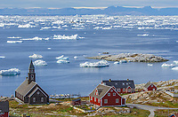 Glacial ice from Jakobshavn Glacier or Sermeq Kujalleq in front of Zion Church or Zions Kirke. Built in Ilulissat in the late 18th century and was the largest man-made structure in Greenland at the time.
