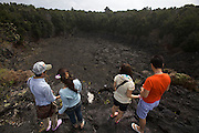 Big Island. Hawai'i Volcanoes National Park. Japanese tourists at Lau Manu Crater.