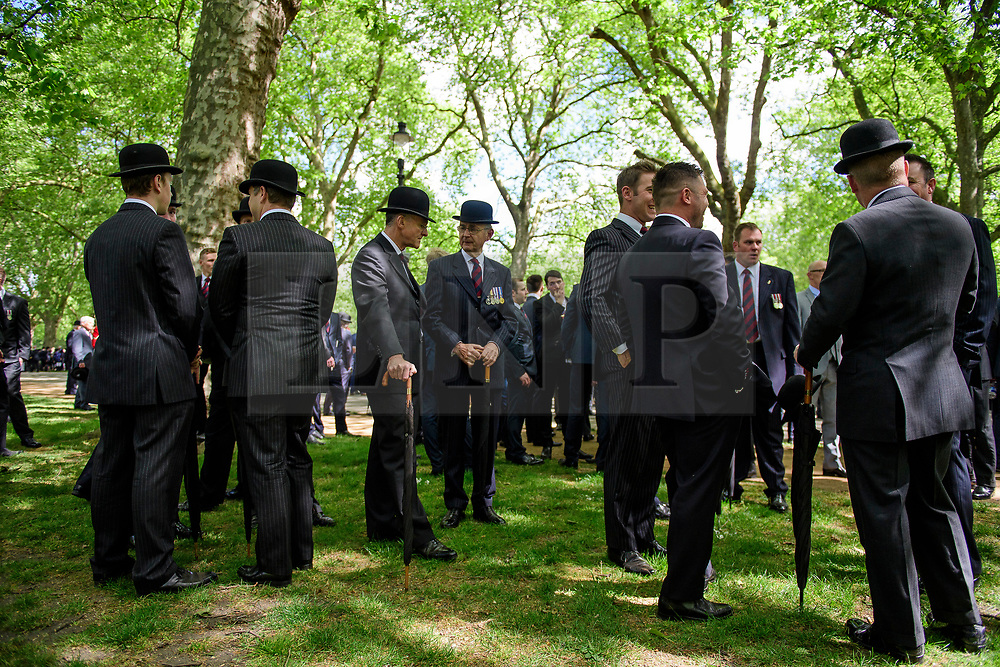 © London News Pictures. 14/05/2017. London, UK. A Cavalryman gather before the parade to starts. Thousands of serving and former Cavalrymen, many wearing bowler hats and carrying closed umbrellas, take part in Combined Cavalry Old Comrades Association Annual Parade in Hyde Park, London. A service of remembrance is held to honour Cavalry and other troops who have fallen in the service of their country since the first world war. Photo credit: Ben Cawthra/LNP