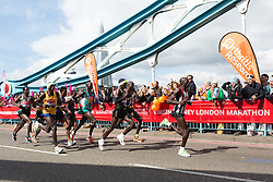 © Licensed to London News Pictures. 24/04/2016. London, UK. Leading elite men, including Kenya's Eliud Kipchoge run over Tower Bridge at the halfway point of the 2016 London Marathon.  Photo credit : Vickie Flores/LNP