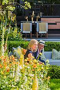 BBC presenters Sophie Raworth and Jo Swift on th LG Eco-City Garden, Sponsor: LG Electronics, Designer: Hay Hwang and Contractor: Randle Siddeley Limited - The RHS Chelsea Flower Show at the Royal Hospital, Chelsea.