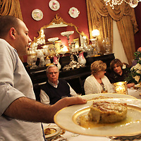 RAY VAN DUSEN/BUY AT PHOTOS.MONROECOUNTYJOURNAL.COM<br /> Chef Edoardo Cecotto of Florence, Italy serves plates of lasagnettes to guests of Tom and Emily Seymer during a recent dinner party. He and Vary Cappelletti served guests a four-course Italian meal.