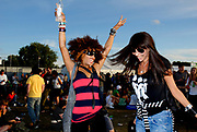Two cute girls dancing wildly, Metro Weekender, Get Loaded In The Park, London 2006
