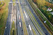 Nederland, Noord-Brabant, Eindhoven, 24-10-2013; Randweg Eindhoven, bij Knooppunt De Hogt, A2 en A 67. Parallelbanen.<br /> Ringroad Eindhoven with motorway junction, parallel lanes.<br /> luchtfoto (toeslag op standaard tarieven);<br /> aerial photo (additional fee required);<br /> copyright foto/photo Siebe Swart.