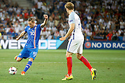 Iceland midfielder Gylfi Þór Sigurðsson (10) has a shot on goal during the Round of 16 Euro 2016 match between England and Iceland at Stade de Nice, Nice, France on 27 June 2016. Photo by Andy Walter.