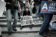 """A protester joining the demonstration orchestrated by Occupy Wall Street. Her sign reads """"We march for hope not hate"""". The Occupy Wall Street demonstrated against financial greed and inequality and questioned the ethics of the financial business."""