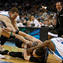 Mar 31, 2010; New Orleans, LA, USA; New Orleans Hornets forward Darius Songaila (9) and forward James Posey (41) fight over a loose ball with Washington Wizards guard Mike Miller (6) as head coach Flip Saunders reacts to the play during the second half at the New Orleans Arena. Mandatory Credit: Derick E. Hingle-US PRESSWIRE