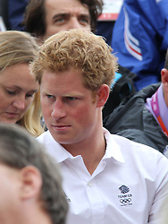 © licensed to London News Pictures. London, UK. 01/08/2012. Prince Harry watching Zara Phillips compete at Olympic Equestrian Showjumping at Greenwich Park on August 1, 2012. Photo credit: Russell Marsh/LNP