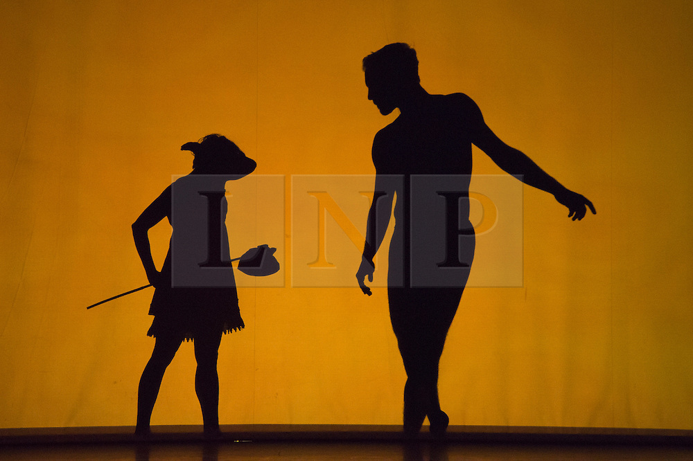 """© Licensed to London News Pictures. 12 March 2014. London, England. Pictured: scene """"Dog Girl"""". Pilobolus dance troupe presents """"Shadowland"""", a show part dance, part circus, part concert utilising multiple moving screens. """"Shadowland"""" is performed for the first time in the UK. Created in collaboration with Steven Banks and featuring a score by David Poe, the show will run from 11 March to 30 March 2014 at the Peacock Theatre, London. Photo credit: Bettina Strenske/LNP"""