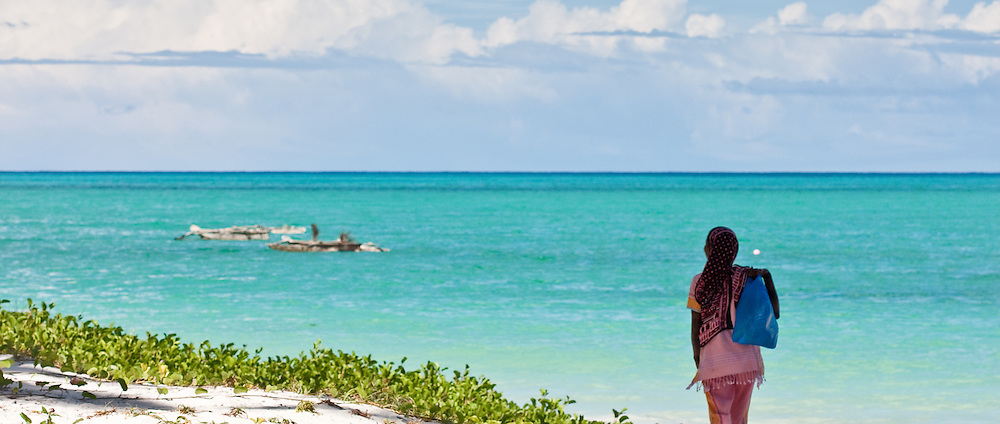 A woman overlooks Paje beach in Zanzibar