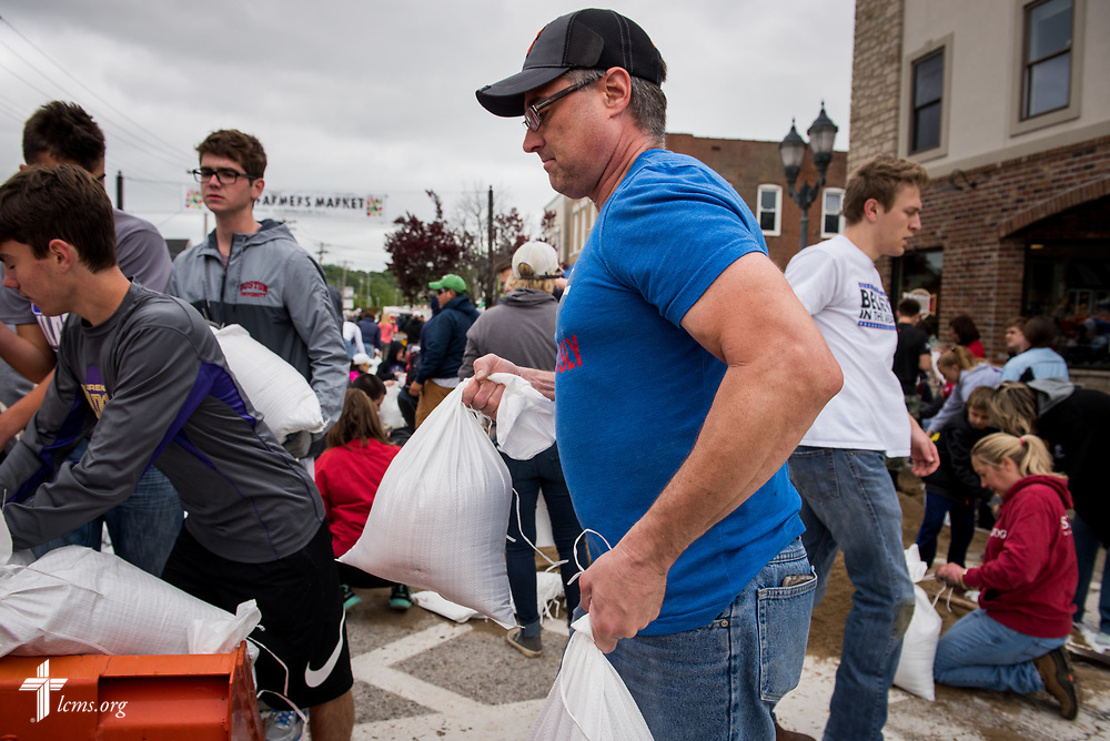 The Rev. Bob Liebmann of St. Mark's Lutheran Ministries, Eureka, Mo.,  helps haul sandbags on Monday, May 1, 2017, in Eureka. He joined fellow church and community volunteers in an effort to protect the town from rising flood waters. LCMS Communications/Erik M. Lunsford
