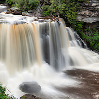 Blackwater Falls, with a heavy flow, plunges the Blackwater River into Blackwater Canyon taking the river off its previously leisurely course.