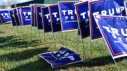Lawn signs are lining the street outside a rally with Mike Pence, Vice-presidential candidate for the Republican Party, at TC Millwork, in Bensalem, PA, on Friday. (Bastiaan Slabbers for NewsWorks)