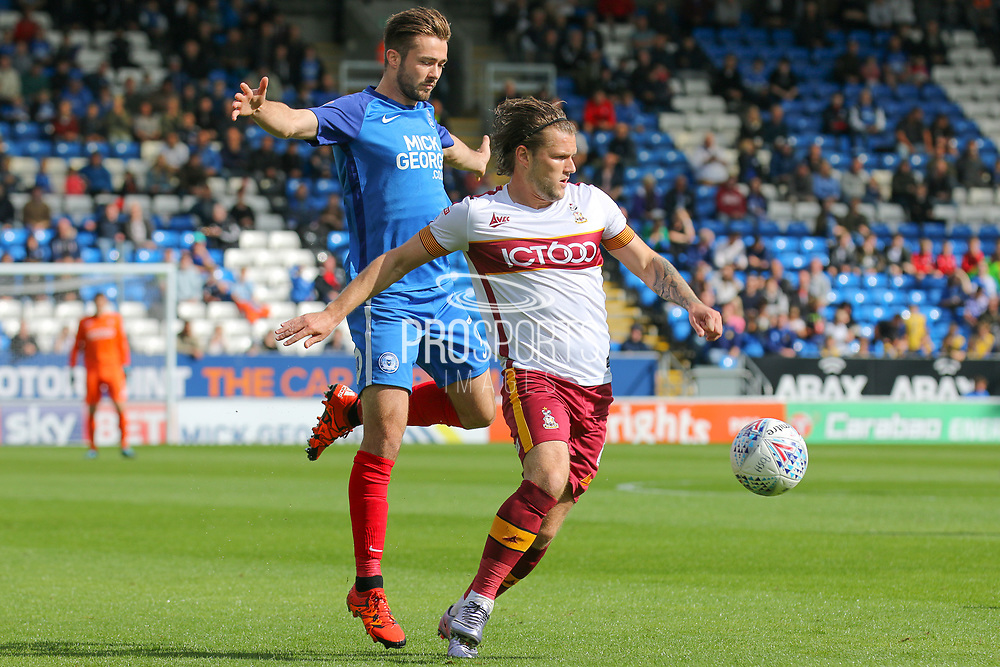 Bradford City midfielder Jake Reeves wins the ball during the EFL Sky Bet League 1 match between Peterborough United and Bradford City at London Road, Peterborough, England on 9 September 2017. Photo by Aaron  Lupton.