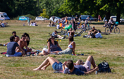 © Licensed to London News Pictures. 31/05/2020. London, UK. Members of the public go out in the sunshine on Wimbledon Common in South West London as weather experts predict another warm weekend with highs of 28c. On Monday, up to six people will be allowed to meet up in parks and private gardens. Photo credit: Alex Lentati/LNP