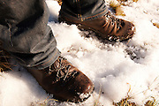 Hiker's boots in the snow on the Moffat Hills, Annandale Way