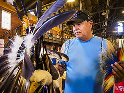 May 6, 2017 - St. Paul, Minnesota, U.S - A member of the Bois Forte Band of Chippewa, near International Falls, MN, prepares his regalia before the 6th Annual Powwow for Hope at Ft. Snelling in St. Paul. The powwow was a fundraiser to support cancer education and supportive services for American Indian communities. Proceeds benefited the American Indian Cancer Foundation's work to eliminate cancer burdens on American Indian families. Cancer is the leading cause of death in Native American communities, exceeding coronary disease and diabetes. (Credit Image: © Jack Kurtz via ZUMA Wire)