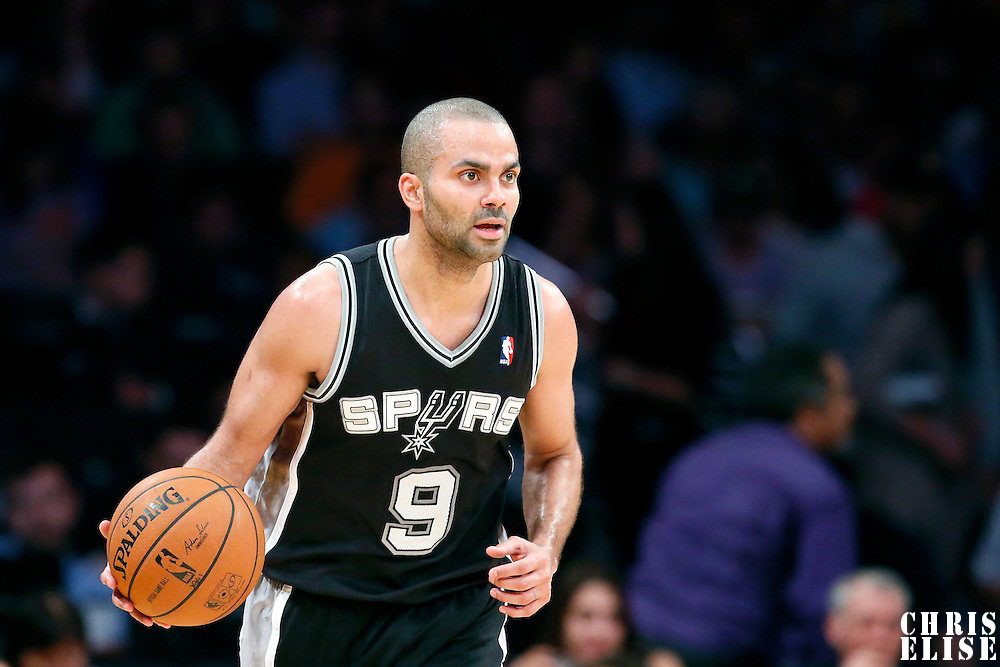 19 March 2014: San Antonio Spurs guard Tony Parker (9) brings the ball up court during the San Antonio Spurs 125-109 victory over the Los Angeles Lakers at the Staples Center, Los Angeles, California, USA.