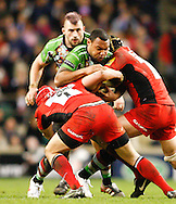 Picture by Andrew Tobin/Focus Images Ltd. 07710 761829. .27/12/11. Jordan Turner Hall (12) of Harlequins is tackled by Rhys Gill (1) of Saracens  during the Aviva Premiership match between Harlequins and Saracens at Twickenham Stadium, London.