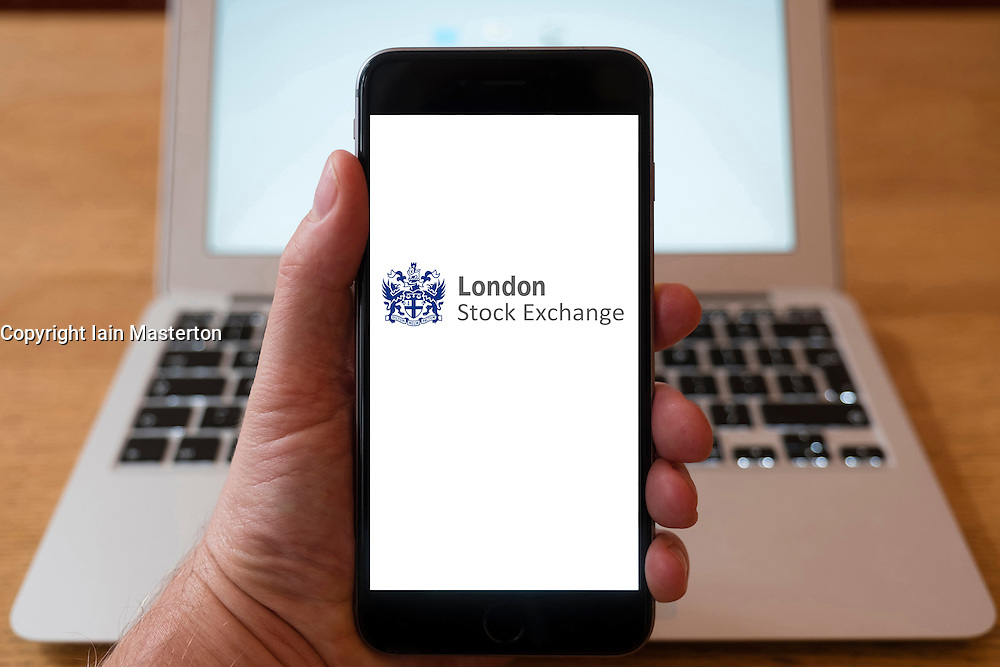Using iPhone smartphone to display logo of the London Stock Exchange