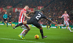 STOKE-ON-TRENT, ENGLAND - Tuesday, January 5, 2016: Liverpool's Nathaniel Clyne is fouled by Stoke City's Marko Arnautovic during the Football League Cup Semi-Final 1st Leg match at the Britannia Stadium. (Pic by David Rawcliffe/Propaganda)