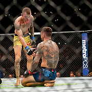 Renato Moicano (yellow trunks) defeats Cub Swanson (blue trunks) by submission in a featherweight bout at UFC 227 held at the Staples Center in Los Angeles on August 4, 2018. Photo by Todd Bigelow for ESPN.