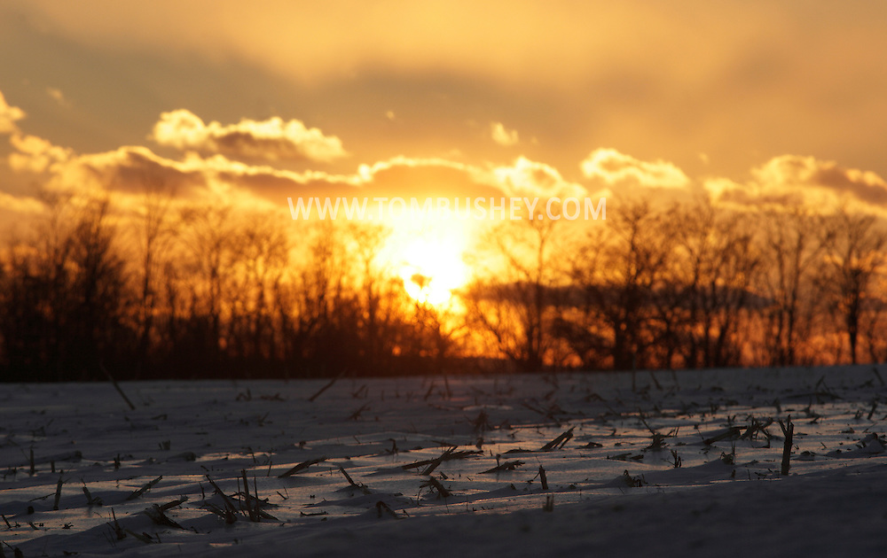 Middletown, New York - The sun sets behind a frozen corn field on Jan. 23, 2011.