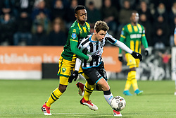 (L-R) Shaquillle Pinas of ADO Den Haag, Reuven Niemeijer of Heracles Almelo during the Dutch Eredivisie match between Heracles Almelo and ADO Den Haag at Polman stadium on February 03, 2018 in Almelo, The Netherlands