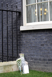 Bouquets of flowers in Downing Street , London,  the day after the death of Baroness Thatcher , Tuesday, 9th April 9th 2013 Photo by: Stephen Lock / i-Images