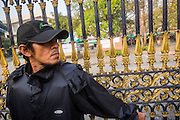 26 JANUARY 2014 - BANGKOK, THAILAND: An anti-government guard blocks the gate to Bang Kapi School during a blockade of the polling place there. Anti-government protestors forced the closure of polling places in Bangkok Sunday as a part of Shutdown Bangkok. Early voting was supposed to be Sunday January 26 but blocked polling places left hundreds of thousands of people unable to vote casting the February 2 general election into doubt and further gridlocking Thai politics. Protestors blocked access to gates and entry ways to polling places and election officials chose the close them rather than confront protestors. Shutdown Bangkok has been going for 12 days with no resolution in sight. Suthep, the leader of the anti-government protests and the People's Democratic Reform Committee (PDRC), the umbrella organization of the protests,  is still demanding the caretaker government of Prime Minister Yingluck Shinawatra resign, the PM says she won't resign and intends to go ahead with the election.    PHOTO BY JACK KURTZ
