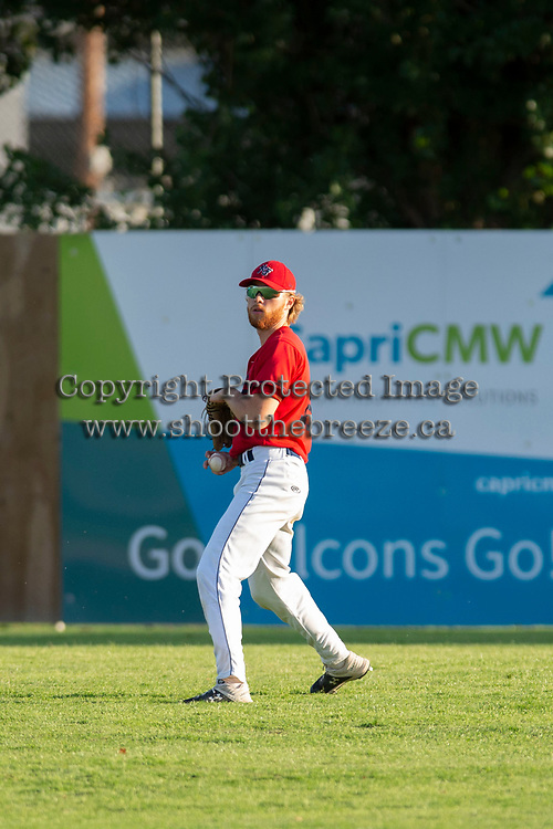 KELOWNA, BC - JULY 17:  Brandon Hupe #18 of the Kelowna Falcons throws the ball from the outfield against the Wenatchee Applesox at Elks Stadium on July 17, 2019 in Kelowna, Canada. (Photo by Marissa Baecker/Shoot the Breeze)