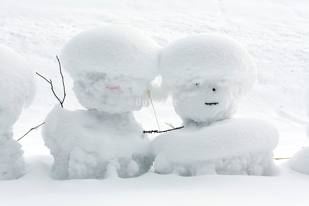 snowmen covered with fresh snow