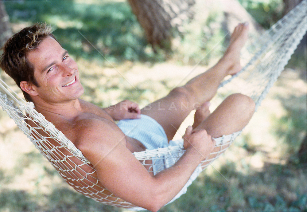 Good looking man in a Hammock