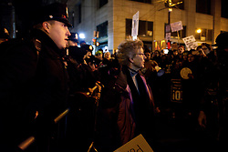 Dale Wilson, of NJ, is seen stepping in-between a charging group of protestors and a police barricade as protest briefly turn violent outside the GOP Retreat in Philadelphia, PA, on January 26th, 2017.
