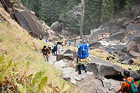 People hiking the Mist Trail in Yosemite National Park, CA.
