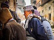 01 MARCH 2017 - KHOKANA, NEPAL: People line up to meet with Nepal government officials who helped them apply for financial assistance for rebuilding homes destroyed in the 2015 earthquake. Recovery seems to have barely begun nearly two years after the earthquake of 25 April 2015 that devastated Nepal. In some villages in the Kathmandu valley workers are working by hand to remove ruble and dig out destroyed buildings. About 9,000 people were killed and another 22,000 injured by the earthquake. The epicenter of the earthquake was east of the Gorka district.     PHOTO BY JACK KURTZ