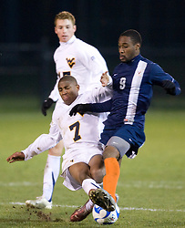 Virginia forward Matt Mitchell (9) battles West Virginia midfielder Gift Maworere (7) for the ball.  The West Virginia Mountaineers defeated the Virginia Cavaliers 1-0 in the second round of the 2007 NCAA Men's Soccer Tournament at Dick Dlesk Stadium in Morgantown, WV on November 28, 2007.