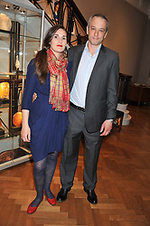 Sculptor FARQUHAR LAING and his wife JILL at a reception to unveil the Limited Centenary Edition of Sir George Frampton's statuette of Peter Pan in aid of the Moat Brae Charity held at The Fine Art Society, 148 New Bond Street, London on 1st May 2012.