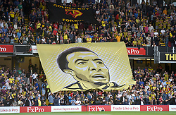 Watford fans in the stands hold up a giant banner for Watford Captain Troy Deeney